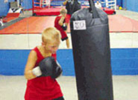Young boxer punching the KO Heavy Bag